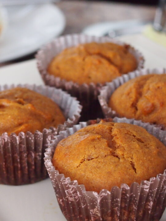 Carrot muffins on white dish.