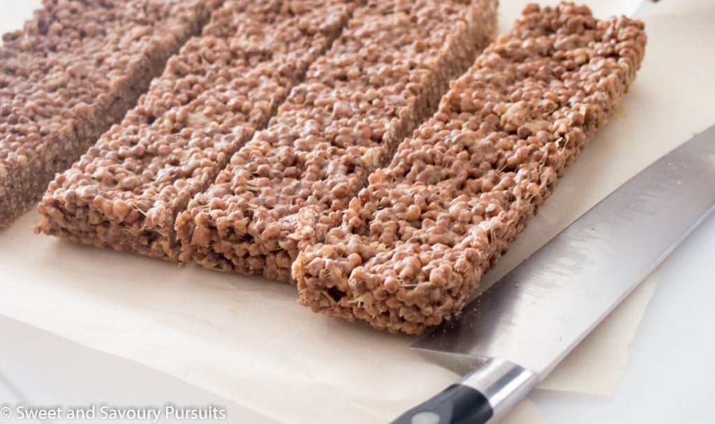 Cocoa Quinoa Puffs and Peanut Butter Squares on cutting board.