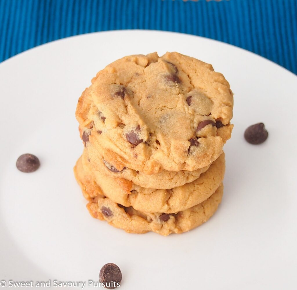 Peanut butter and chocolate chip cookies on dish.