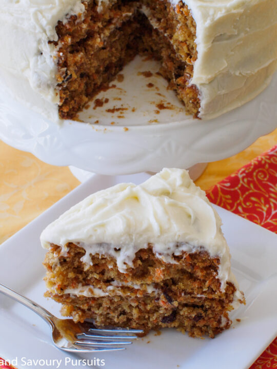 A slice of carrot cake on a dish.