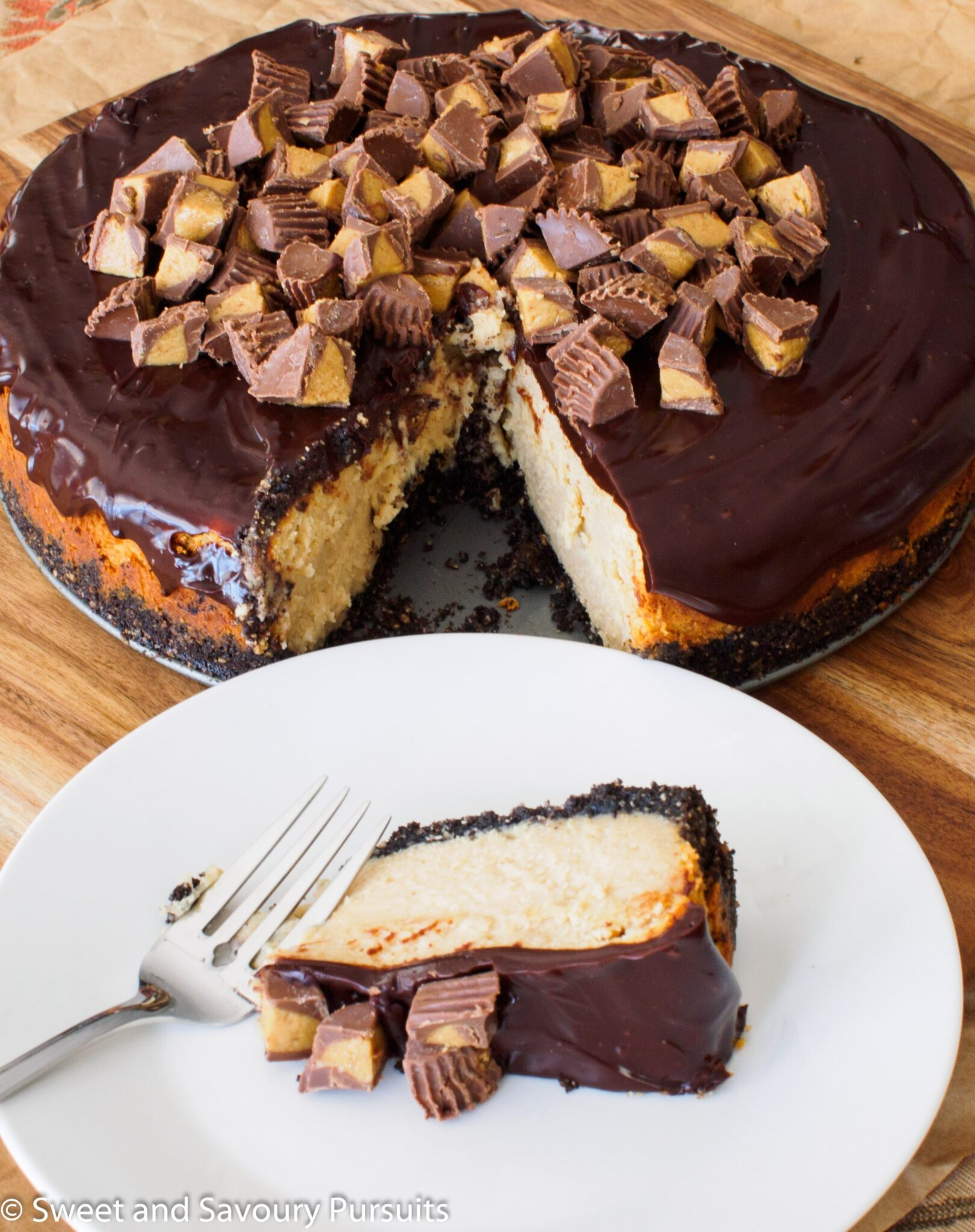 Slice of Peanut Butter and Chocolate Cheesecake on dish.