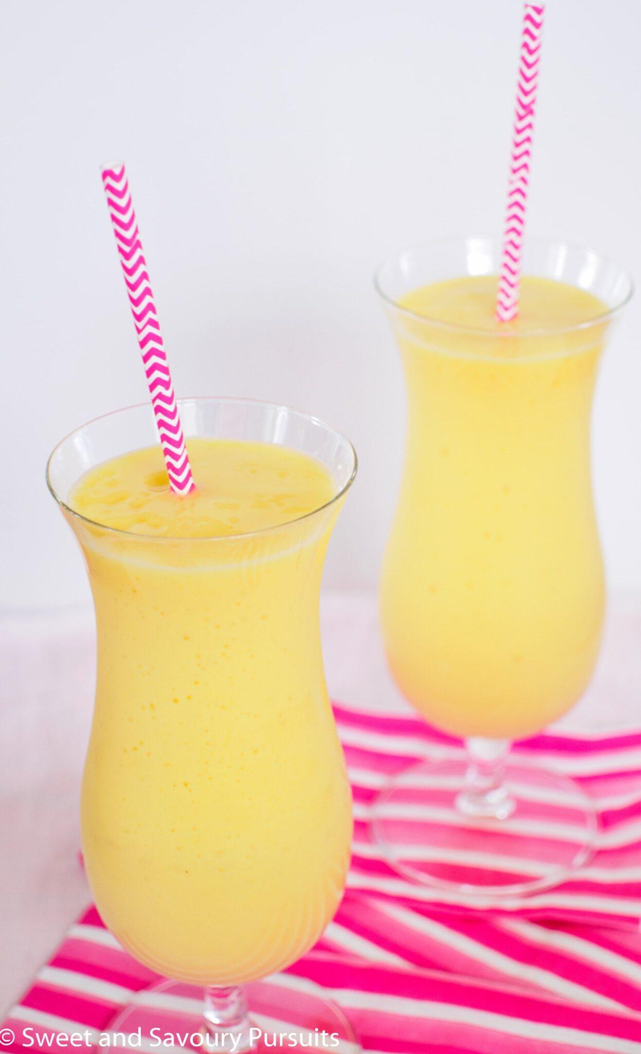 Two Pineapple, Mango and Orange Smoothies.