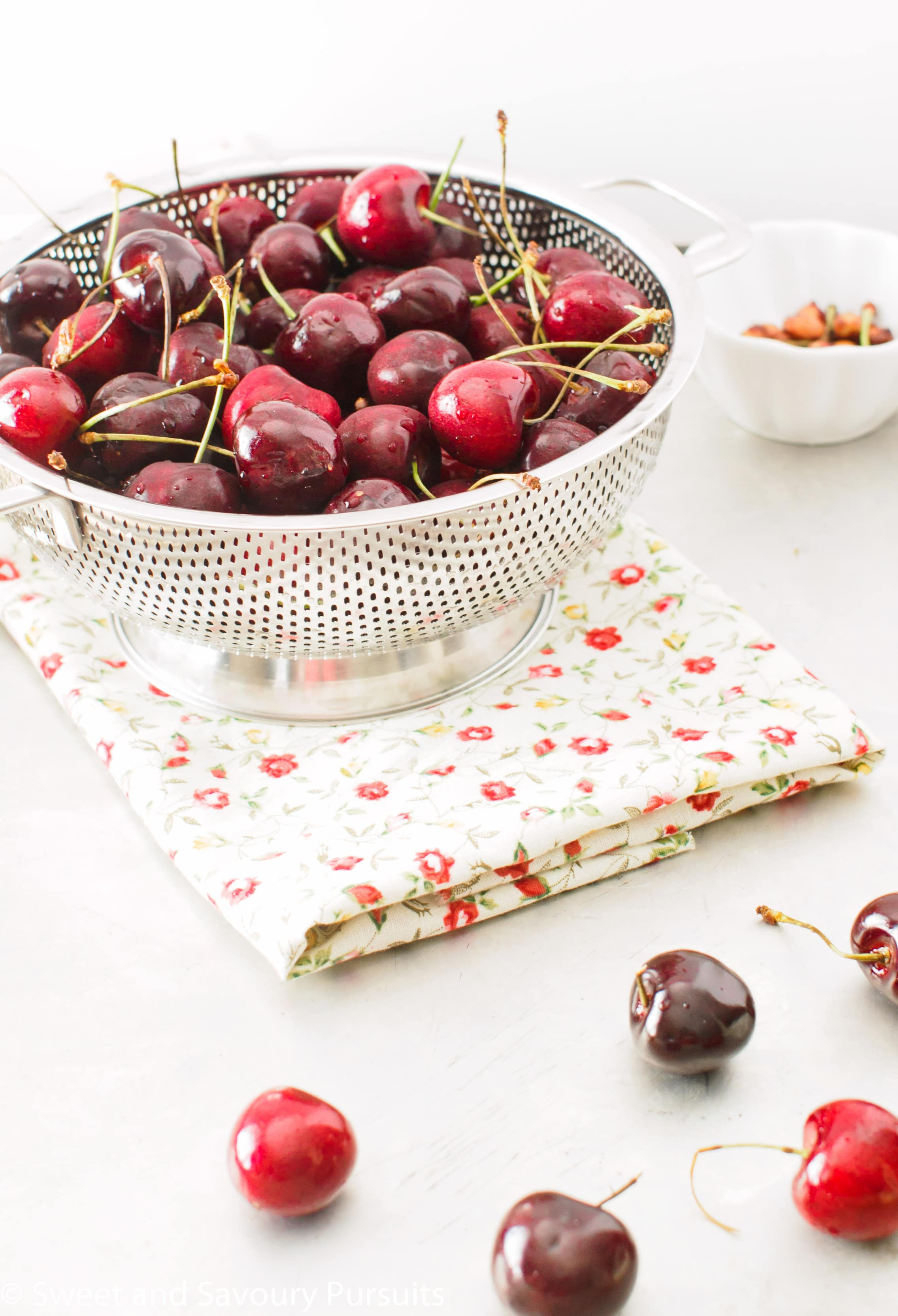 Colander full of freshly washed cherries.