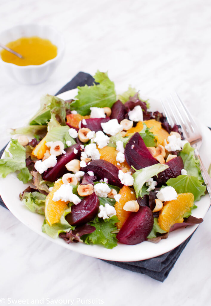 Plate of Roasted Beet and Orange Salad served with Citrus Vinaigrette.