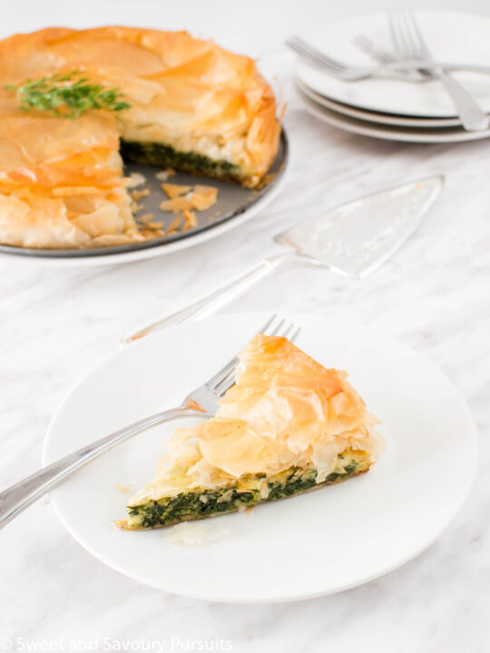 Slice of Spanakopita pie on dish.