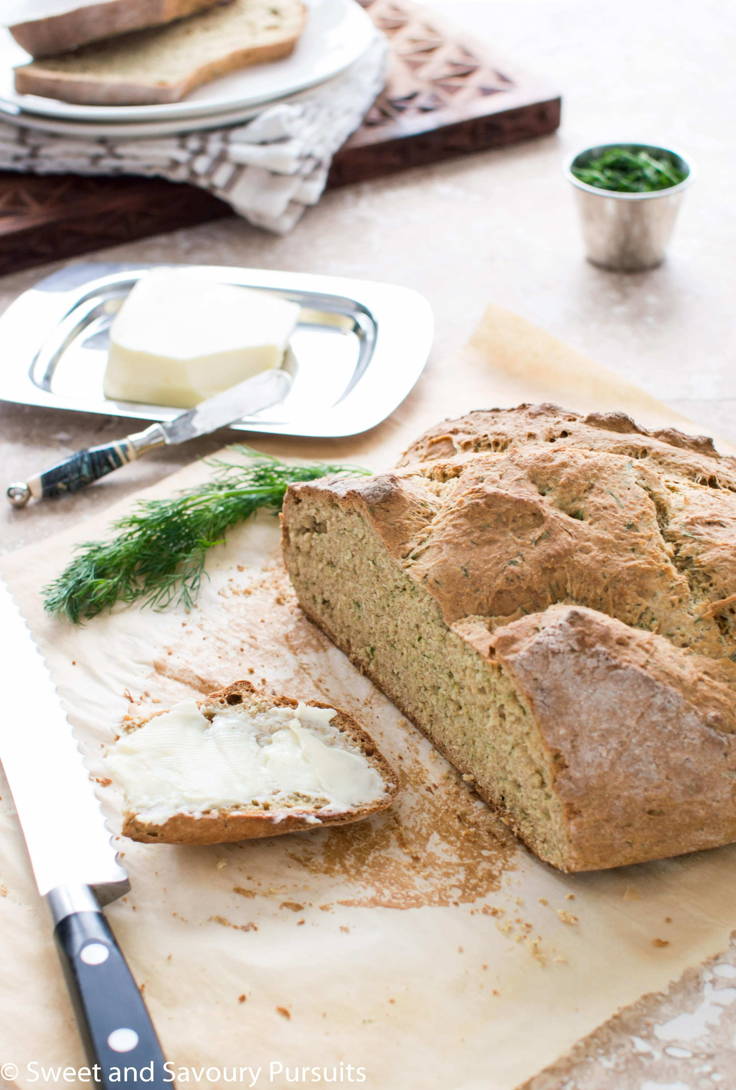 Irish Soda Bread with cut and buttered slice.