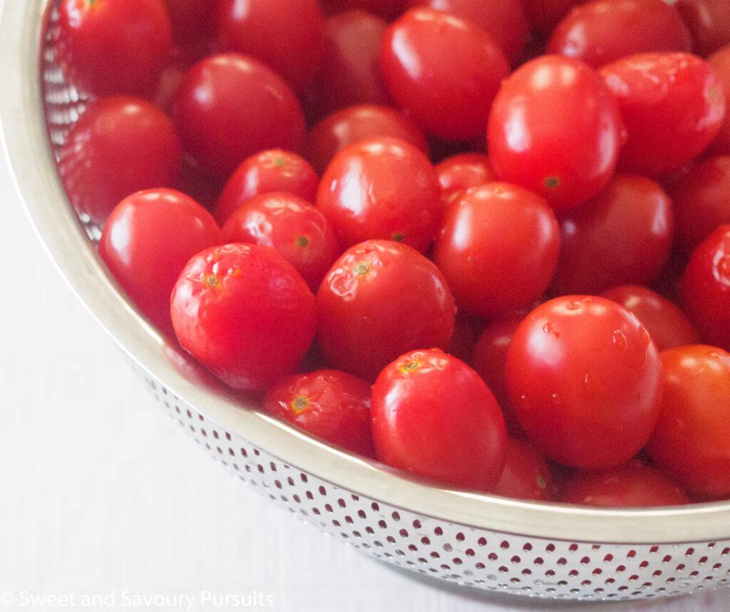 Fresh Grape Tomatoes in colander.