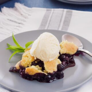 Blueberry cobbler topped with vanilla ice cream.