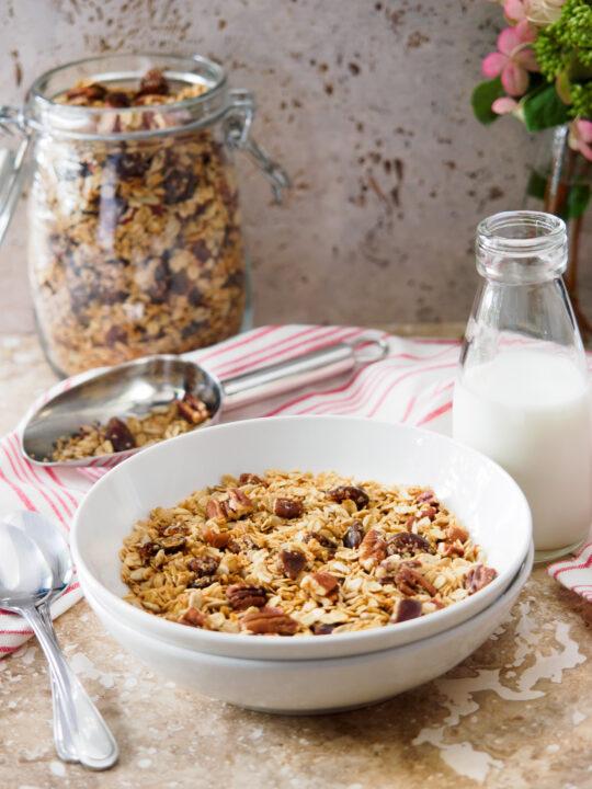 Bowl of vegan Homemade Maple Pecan Granola with Dates.