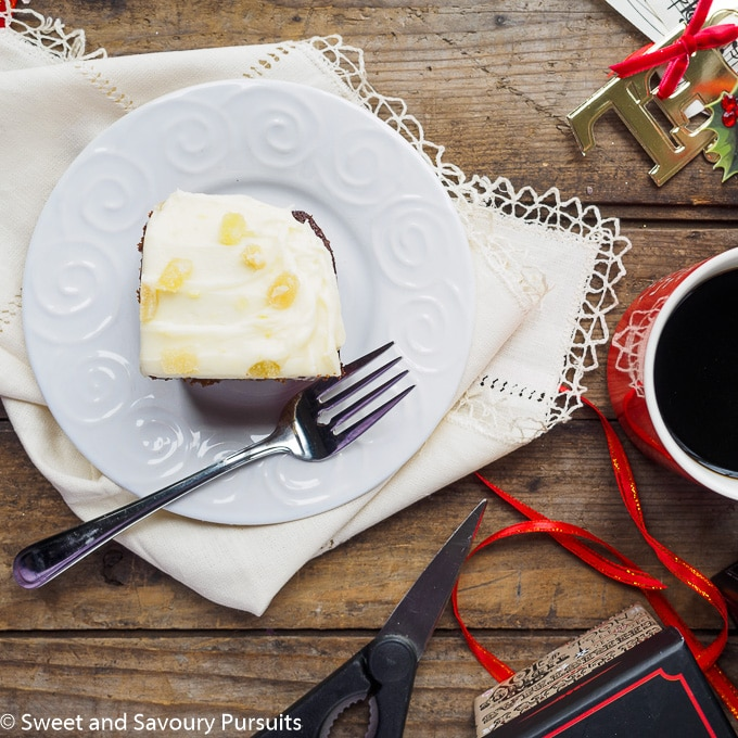 Slice of gingerbread cake topped with cream cheese frosting.