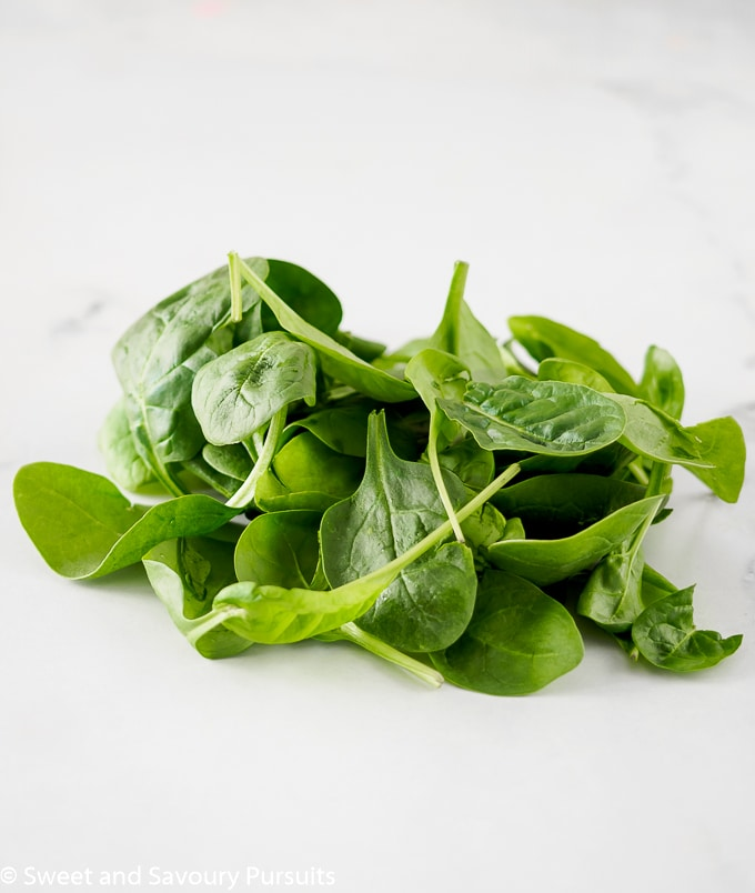 Bunch of baby spinach on board.