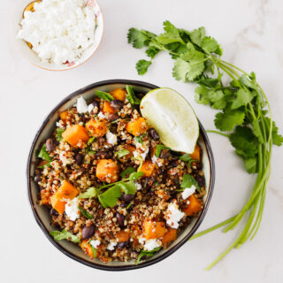 Top view of a bowl filled with sweet potato, black beans and quinoa.
