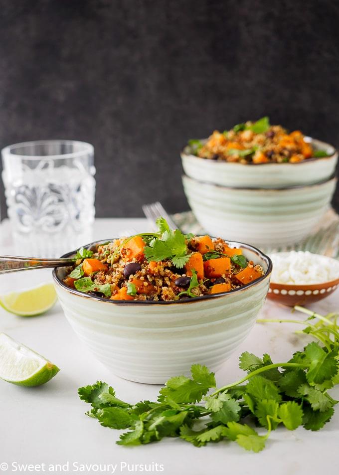 Sweet Potato and Black Bean Quinoa bowl topped with fresh cilantro.