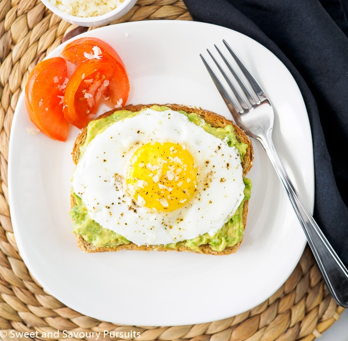Avocado toast topped with fried egg.