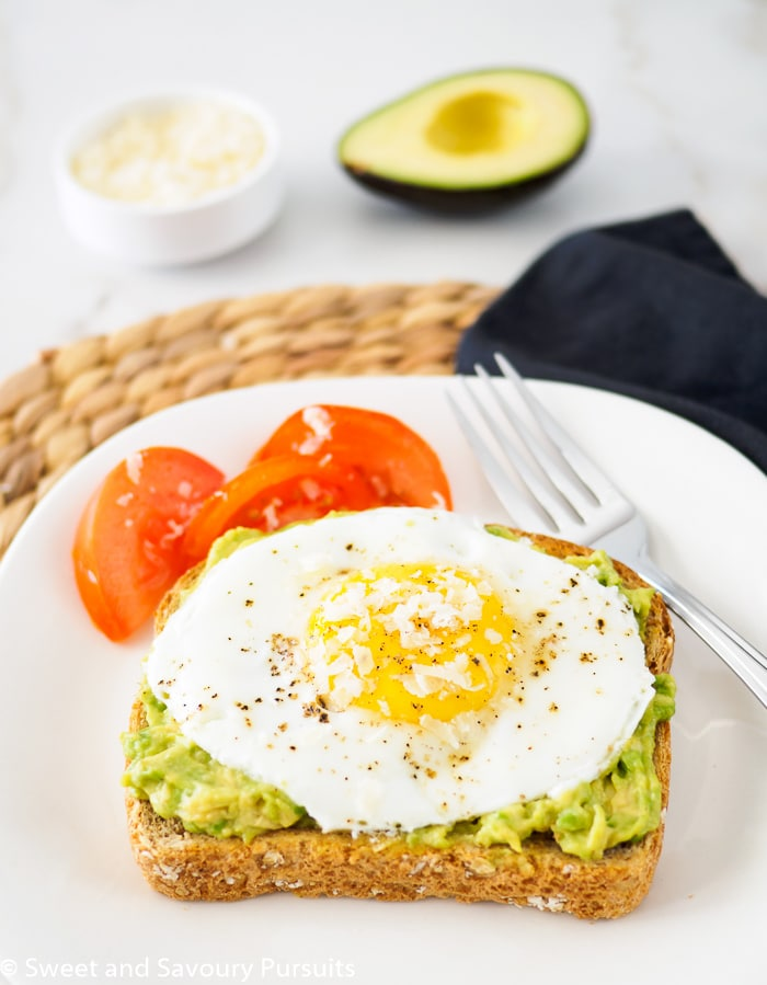 Toast topped with avocado and fried egg.