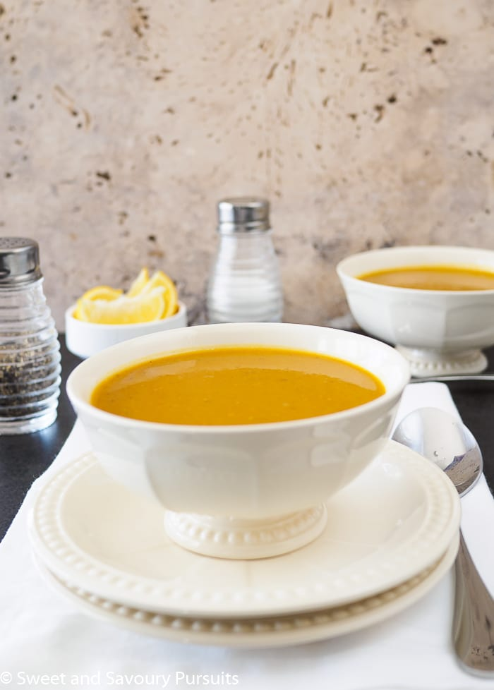 Two bowls of curried sweet potato and lentil soup.