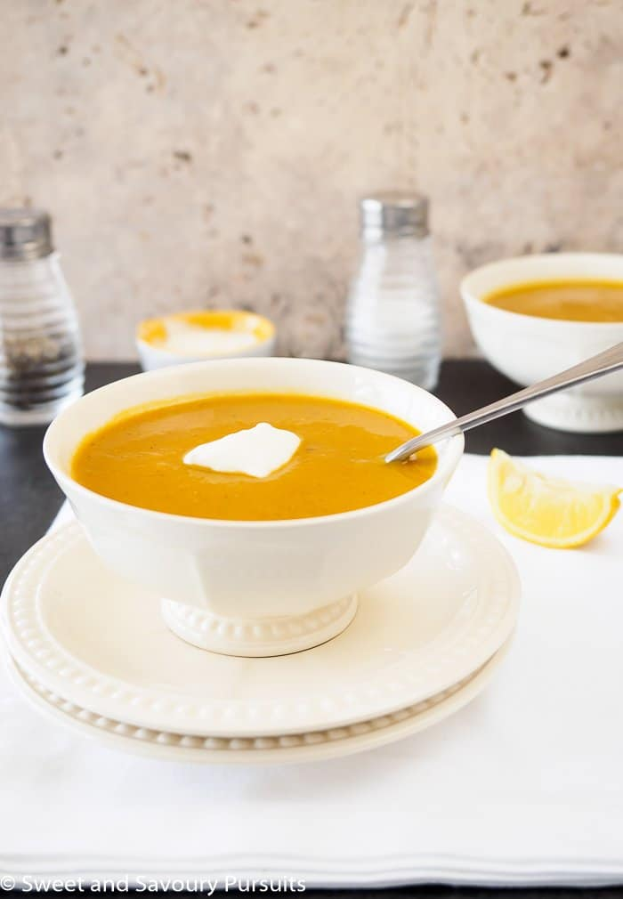 Bowl of Sweet Potato and Red Lentil Soup topped with a dollop of yogurt.