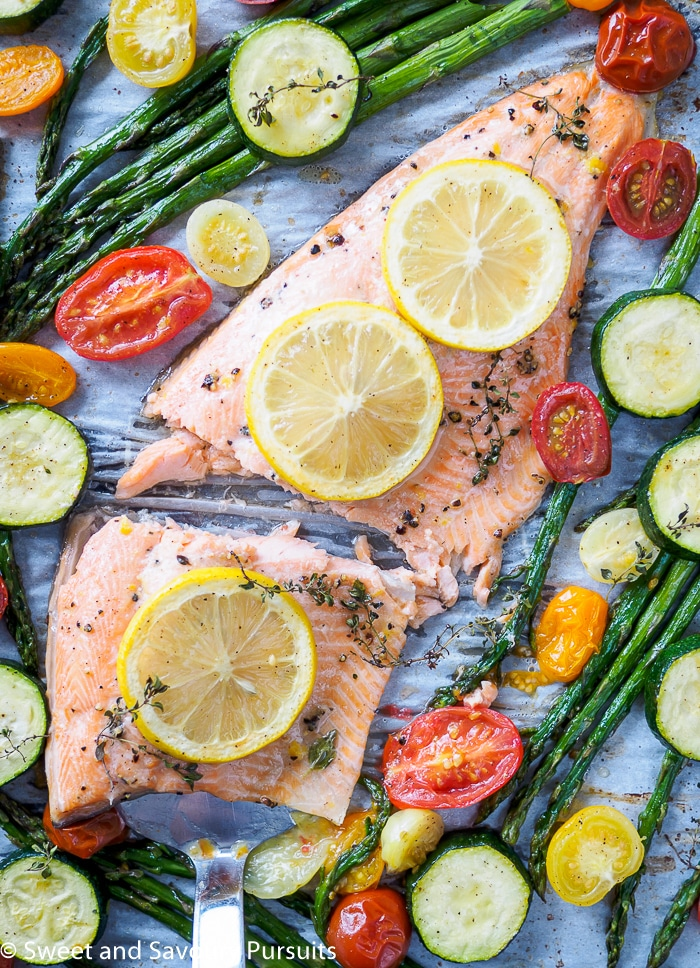 Rainbow Trout Fillet with asparagus, cherry tomatoes and zucchini baked all on one tray.