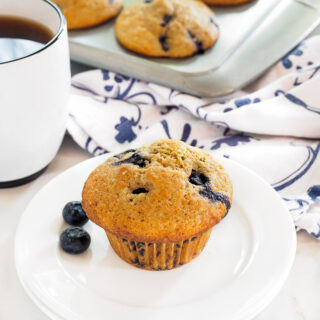 Whole Wheat Blueberry Lemon Muffin served with a cup of coffee