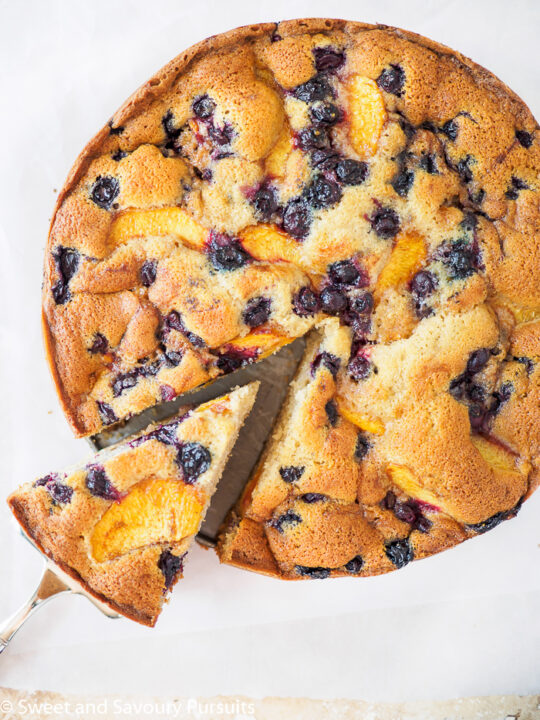 Top view of a Peach and Blueberry Cake.