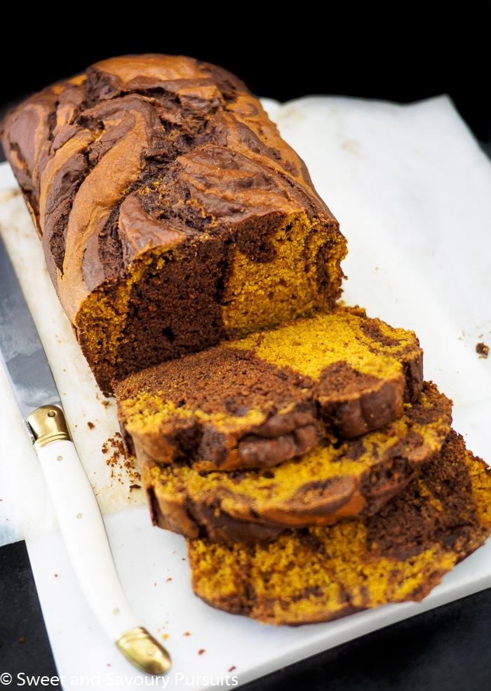 Sliced chocolate swirled pumpkin loaf.