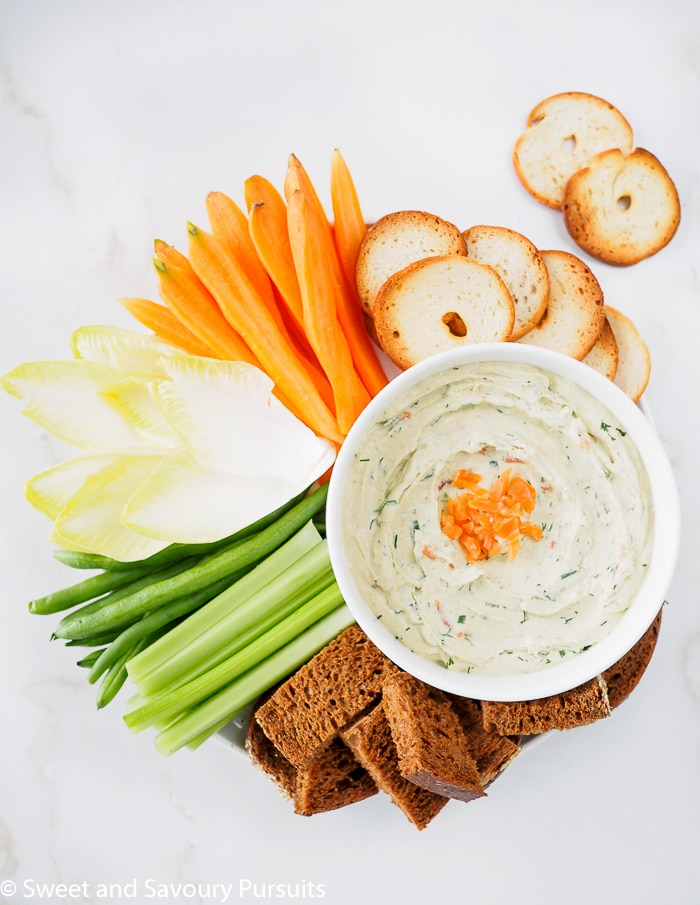 A Smoked Salmon Cream Cheese Dip served with veggies, bread and bagel crackers.