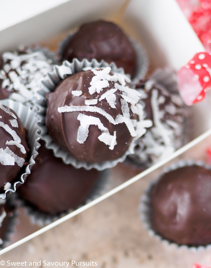 Top view of a box of chocolate coconut truffles.