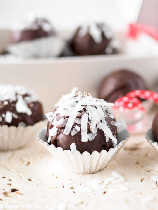 Chocolate Coconut Almond Truffles in foil candy cups.