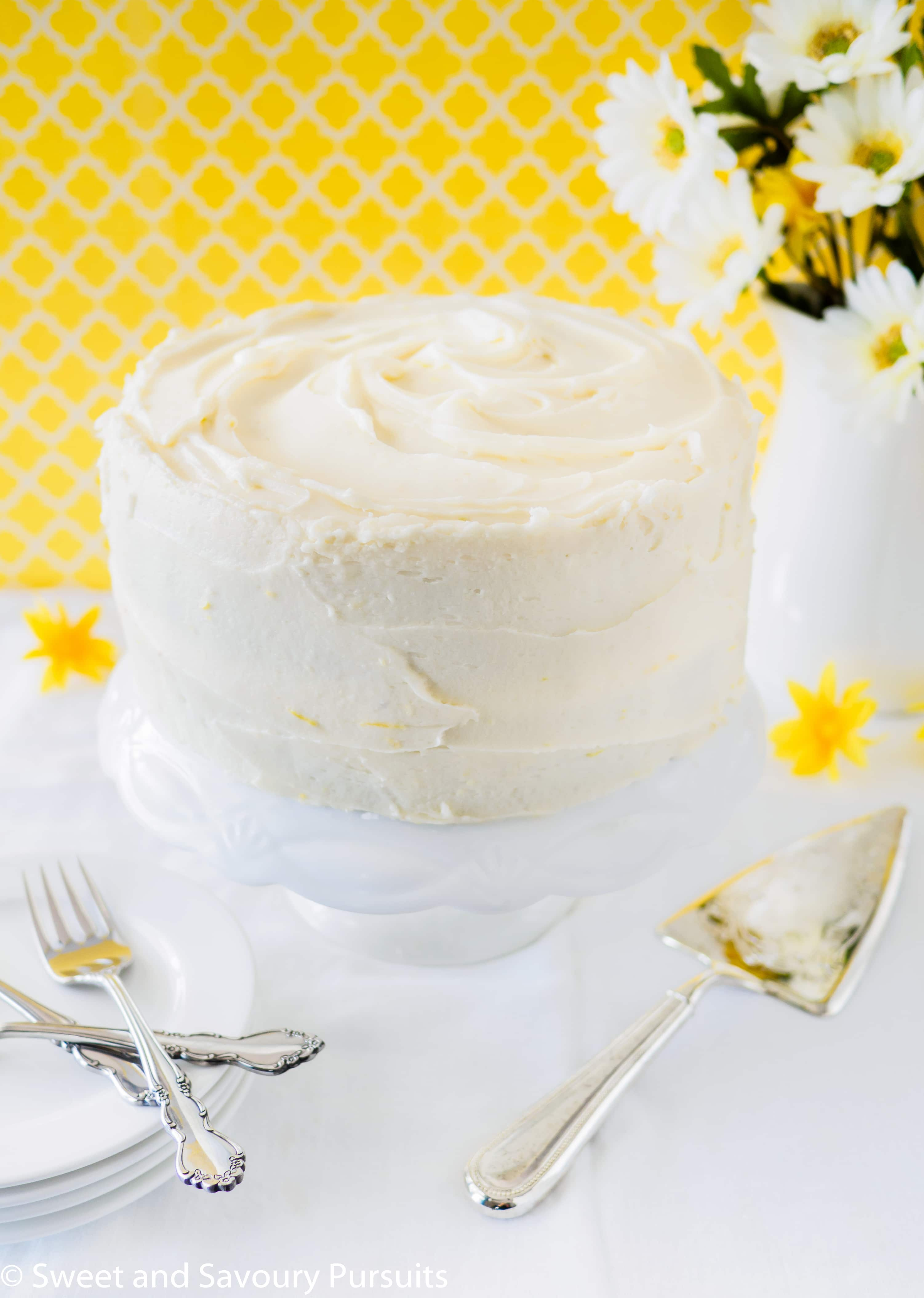 A layered Lemon Poppy Seed Cake frosted with a lemon infused Cream Cheese Frosting.