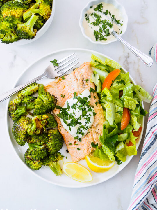 A serving of Baked Rainbow Trout Fillets with Roasted Broccoli on dish.