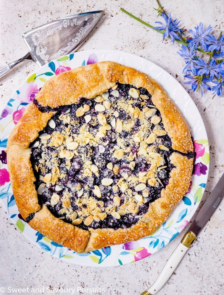 A Blueberry Almond Crumble Galette on a plate.