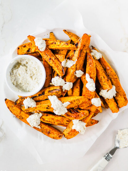 Baked Sweet Potato wedges topped with softened Feta cheese.