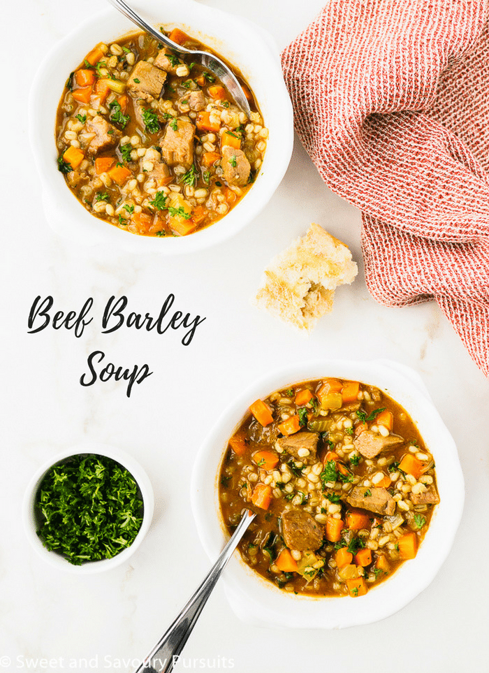 Beef Barley Soup served in two white bowls.