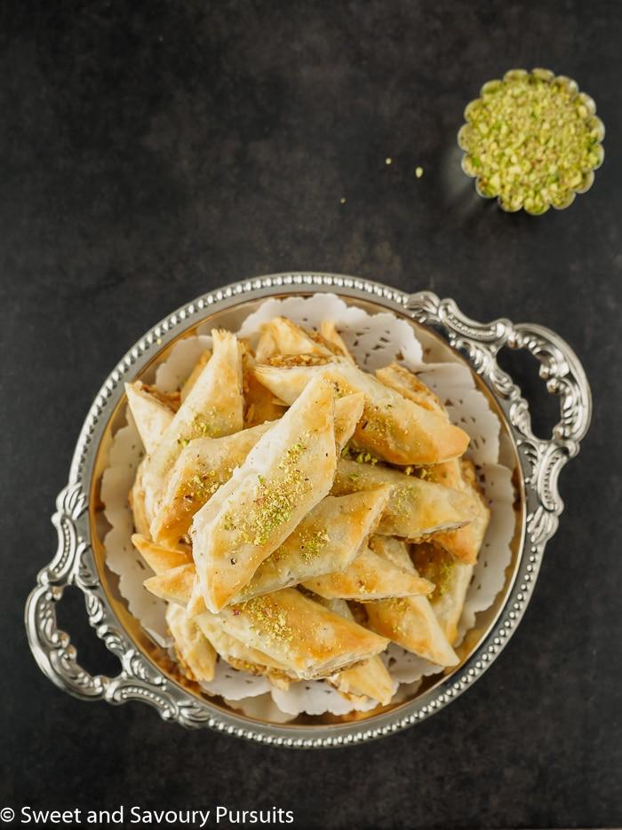 Dish of walnut Baklava rolls.