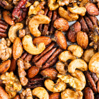 Roasted seasoned nuts on baking tray.