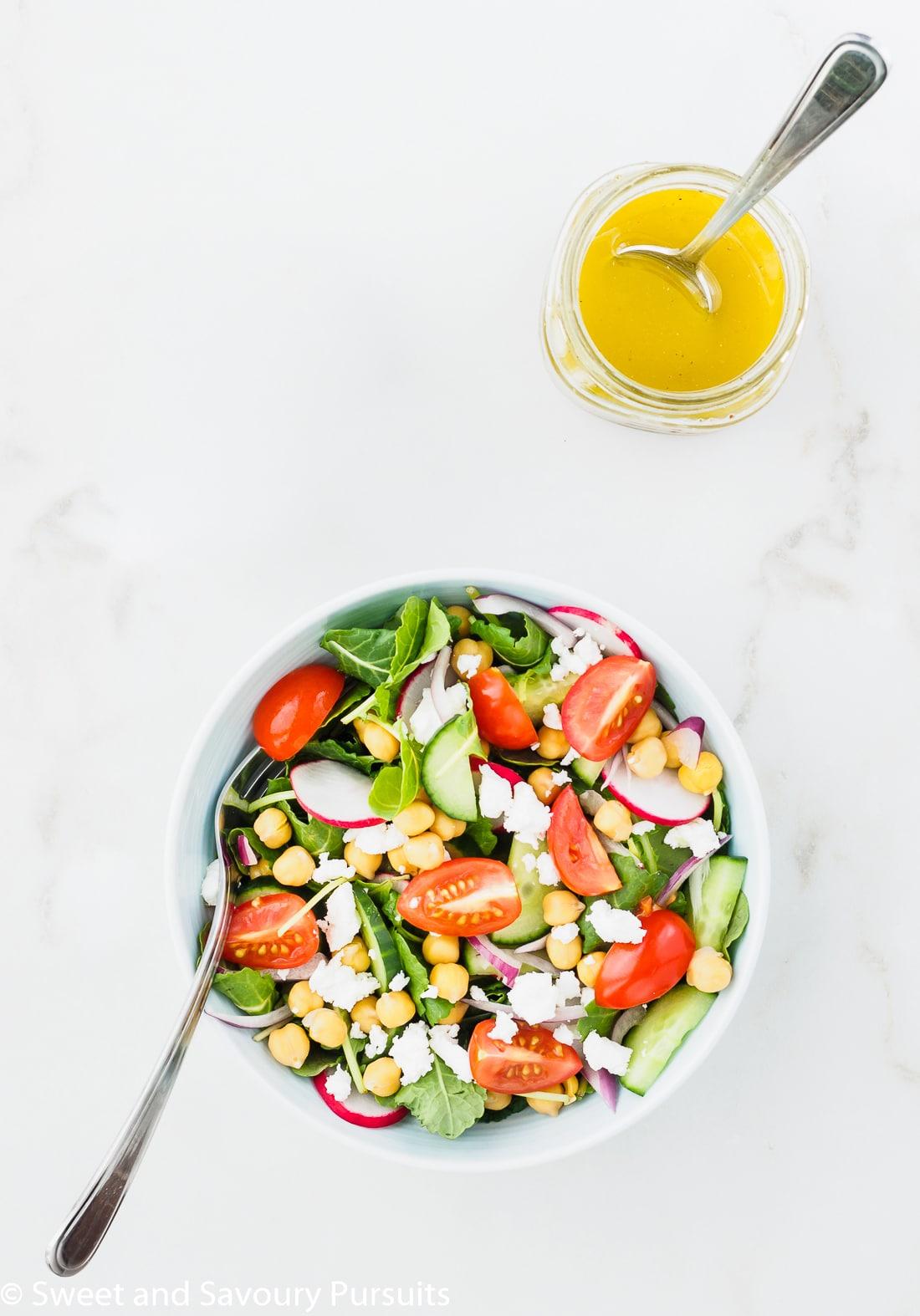 Mediterranean Kale Salad served with lemon garlic dressing on the side.