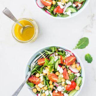 Mediterranean Kale Salad served with lemon and garlic salad dressing.