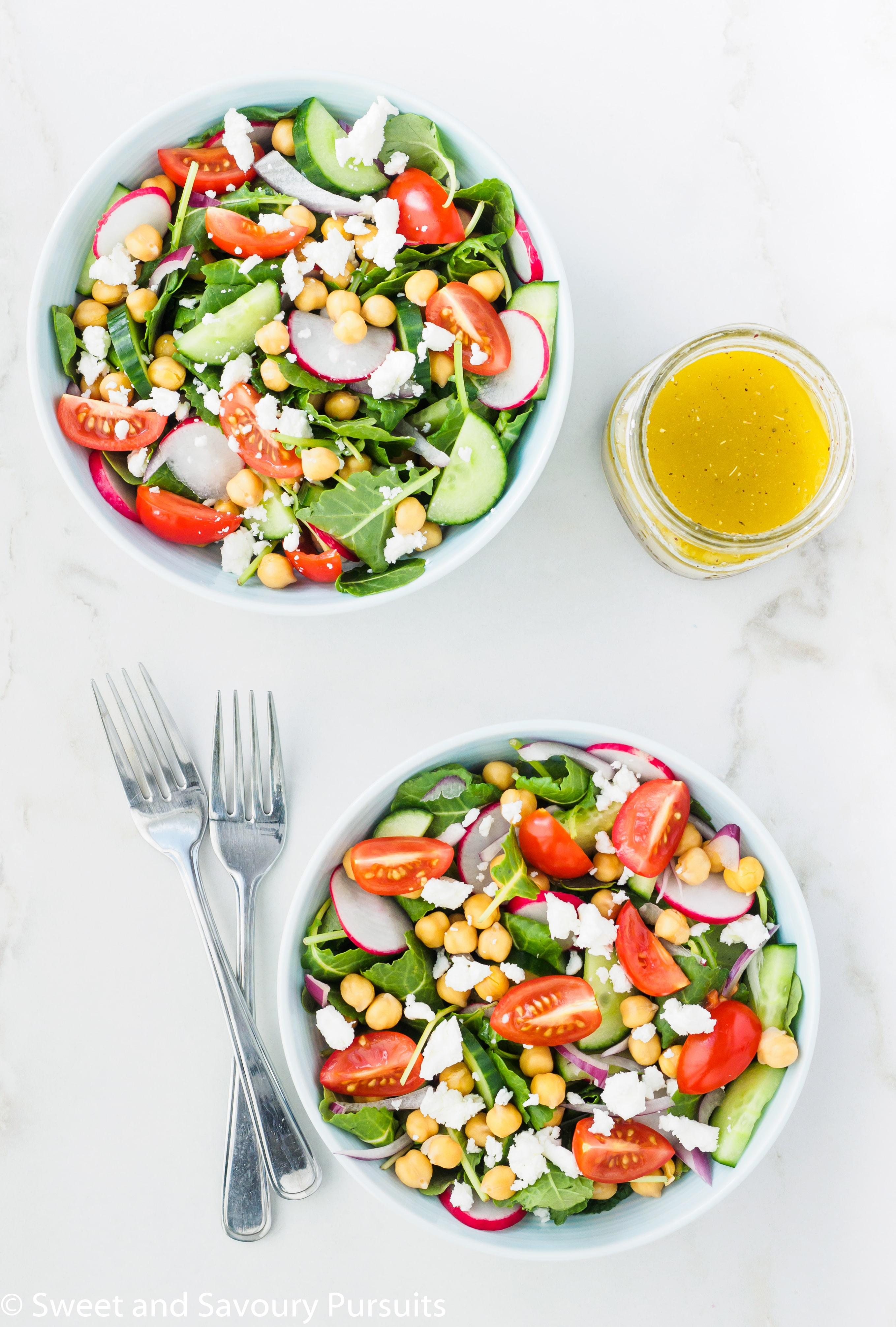 Mediterranean Kale Salad with chickpeas served with a lemon garlic dressing on the side.