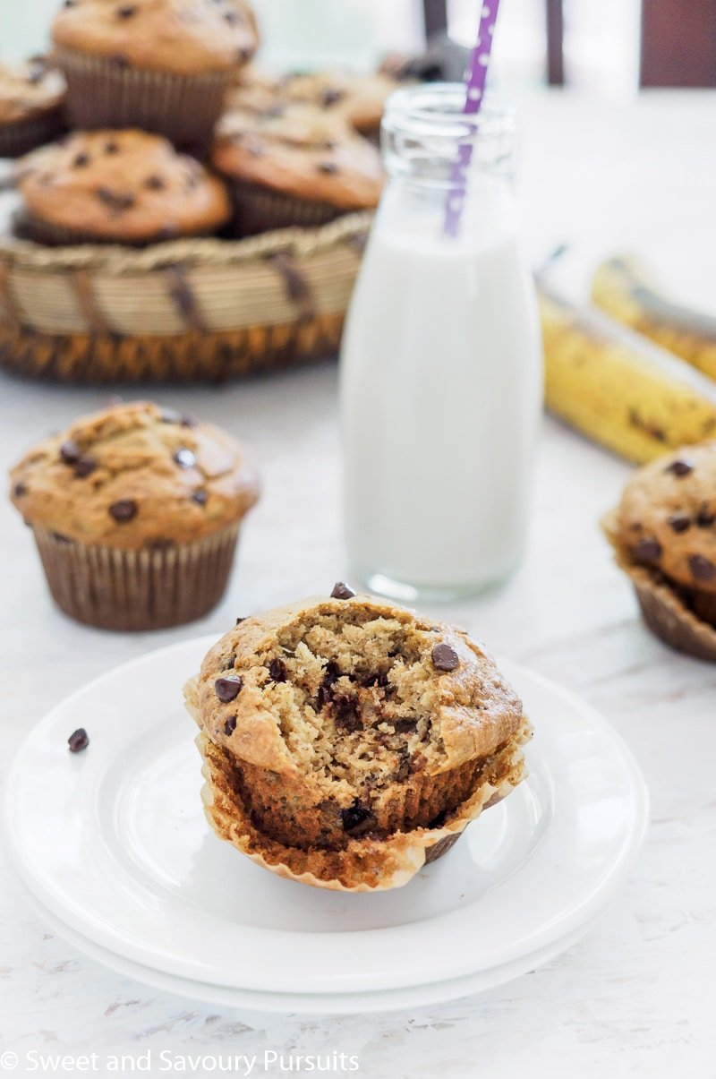 Partially eaten Banana Oatmeal Chocolate Chip Muffin with more muffins in the background.