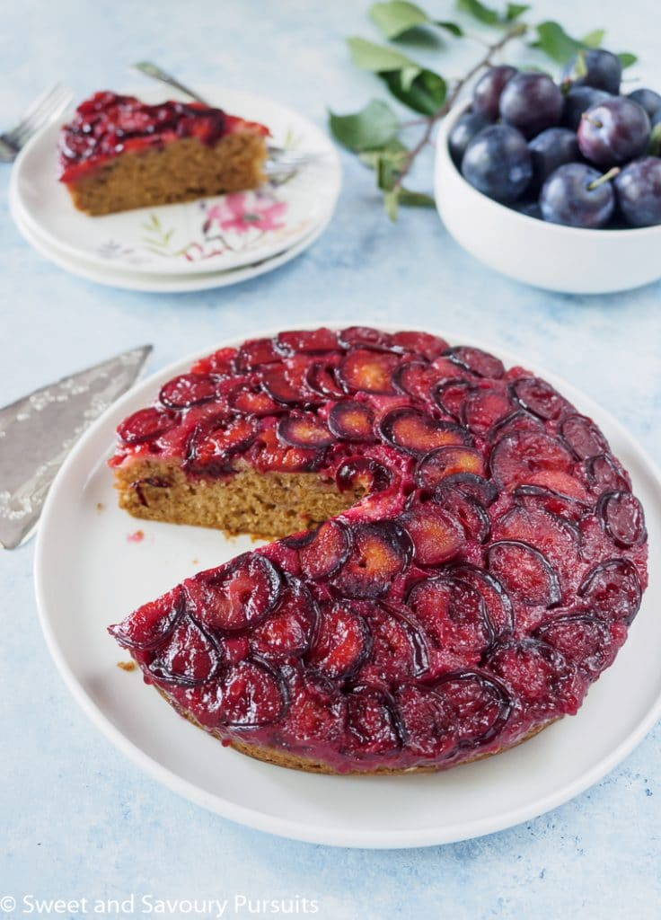 Plum cake with slice removed.
