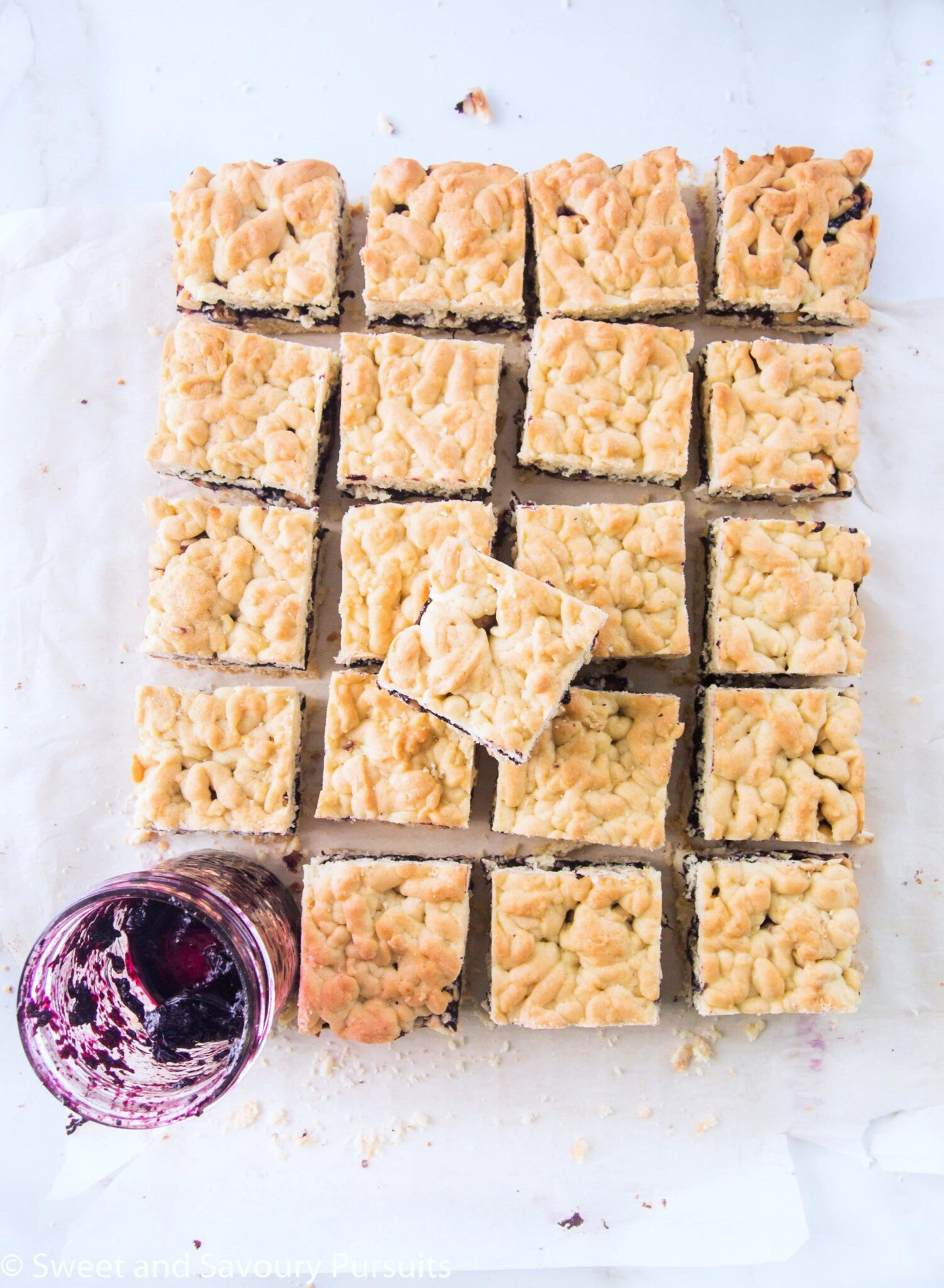 Top view of blueberry jam and hazelnuts bars.