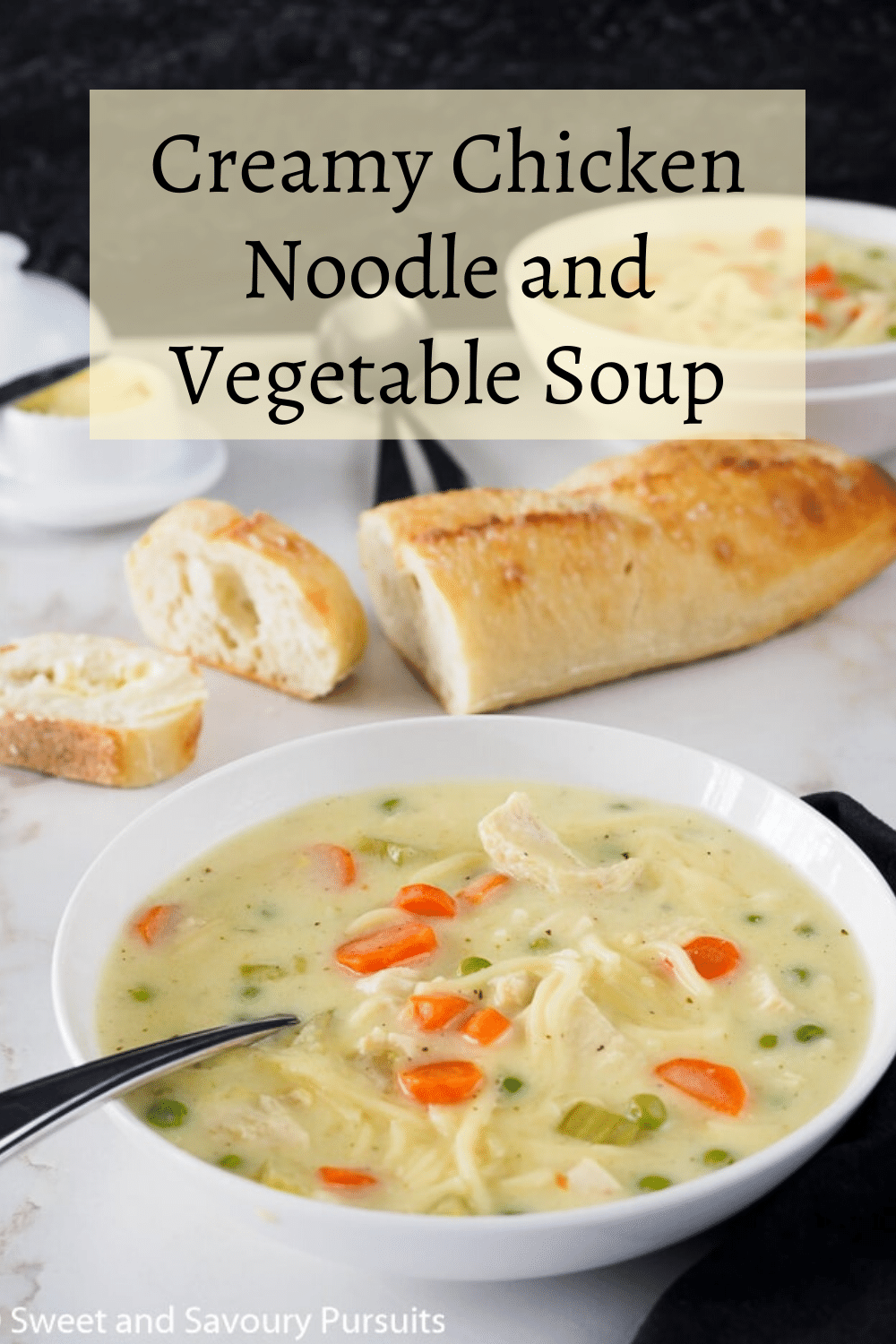 Bowl of creamy chicken noodle and veggie Soup.
