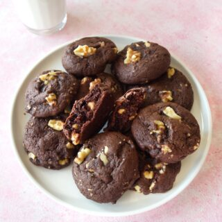 Close up of a plate of Fudgy Chocolate Walnut Cookies