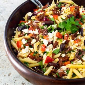 Mediterranean Pasta Salad in a large wooden bowl.
