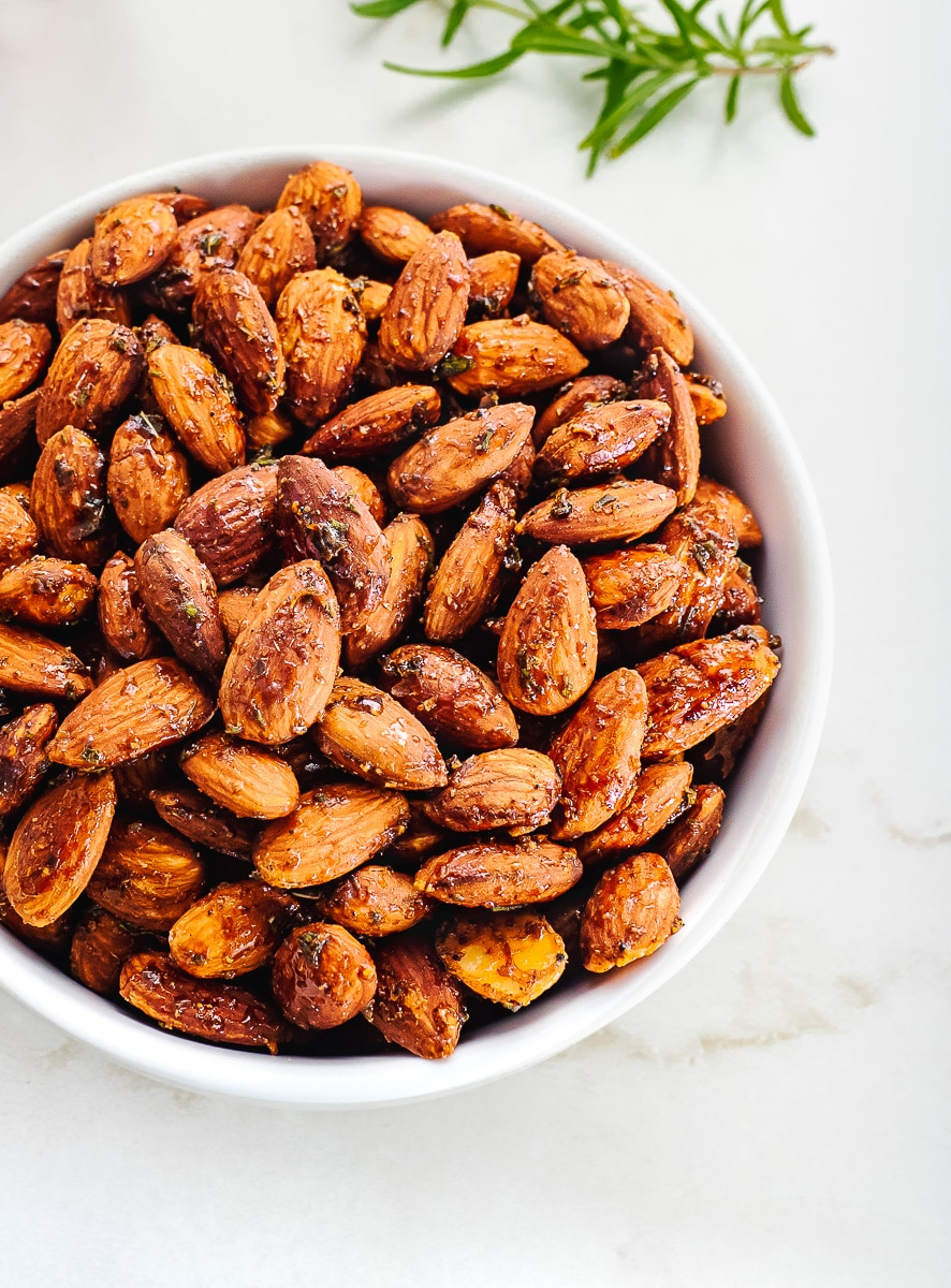 Roasted and seasoned almonds in bowl.