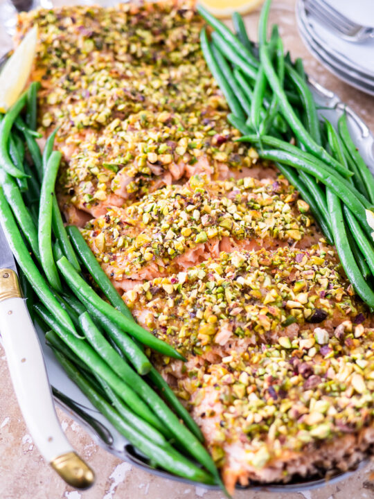 Filet of pistachio crusted salmon on platter.