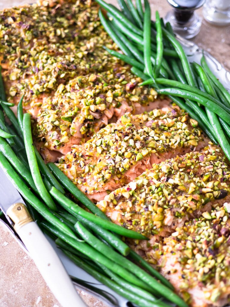 Up-close image of a pistachio crusted salmon filet.